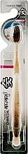 Духи, Парфюмерия, косметика Зубная щетка с древесным углем и двухуровневой щетиной, оранжевая - White Charcoal Toothbrush