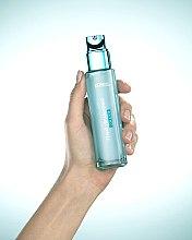 """Аква-флюид для лица """"Гений Увлажнения"""" для сухой и чувствительной кожи - L'Oreal Paris — фото N6"""