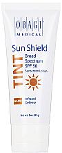 Духи, Парфюмерия, косметика Тонирующий солнцезащитный крем - Obagi Medical Sun Shield Tint Broad Spectrum Spf 50 Warm