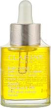 Духи, Парфюмерия, косметика Масло для лица для сухой кожи - Clarins Santal Face Treatment Oil