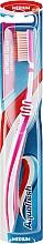 Духи, Парфюмерия, косметика Зубная щетка средней жесткости, розовая - Aquafresh Interdental