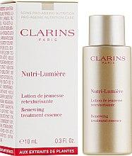 Духи, Парфюмерия, косметика Восстанавливающий лосьон для лица - Clarins Nutri-Lumiere Renewing Treatment Essence (пробник)
