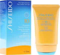 Духи, Парфюмерия, косметика Легкий солнцезащитный тонирующий крем для лица - Shiseido Suncare Protective Tanning Cream N SPF 10 For Face